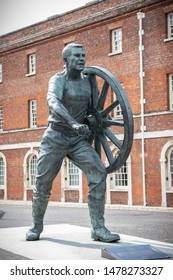 08/13/2019 Portsmouth, Hampshire, UK A statue inside Portsmouth Dockyard Commemorating The old naval Sport Of Field Gun