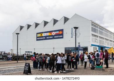 08/13/2019 Portsmouth, Hampshire, UK Tourists Gather inside Portsmouth's Historic Dockyard
