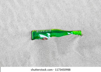 08/21/2018 eastern desert of saudi arabia: a 7up soft drink bottle buried in the sand
