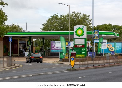 08/24/2020 Portsmouth, Hampshire, UK The exterior of a BP petrol station or gas station with a car entering the forecourt