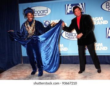 08DEC97:  Pop star BUSTA RHYMES (left) & Vegas veteran singer WAYNE NEWTON at the Billboard Music Awards at the MGM Grand in Las Vegas.