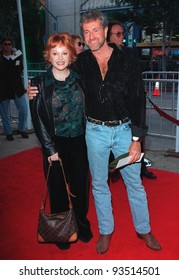 "08NOV98: Actress CHARLENE TILTON with director CHARLIE ADAMS at Hollywood premiere of his new film ""The Rugrats Movie."""