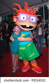 "08NOV98: Actress CHRISTINE CAVANAUGH, who plays the voice of ""CHUCKIE"" with the character at Hollywood premiere of ""The Rugrats Movie."""