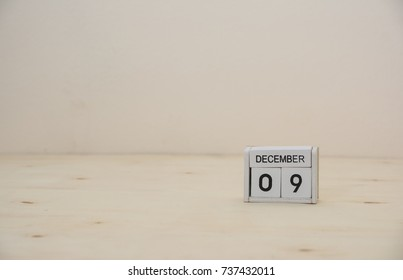 09 December wooden cube calendar on wood surface with copy space