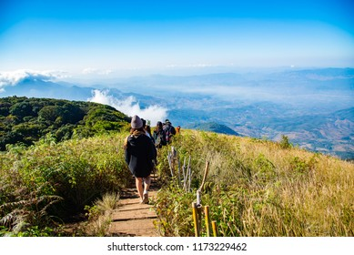 09 JULY 2018 Group of people walking on mountain in morning sunrise, trekking on the Kew Mae Parn,Inthanon National Park mountain in Thailand.