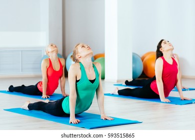 09/03 group women are practicing yoga exercises in the studio. itness, sport, people and healthy lifestyle concept