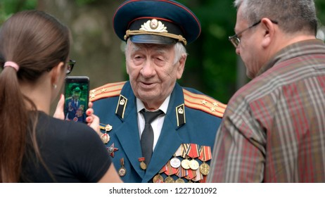 09.05.2018 - Kyiv, Ukraine. War veteran in uniform with different medals and awards. Elderly colonel general of Second World War. Great Victory Day. Holiday after parade.