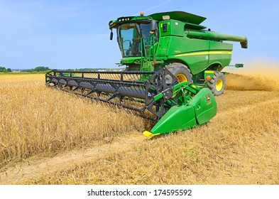 09/07/2013. Western Ukraine, near the town Kalush. Modern John Deere combine harvesting grain.