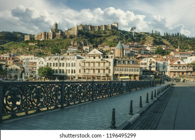 09/08/2018 Tbilisi City Georgia. Bridge over the Kura River leading to Meydan Square. View of the historic city center and Narikala Fortress on the hill