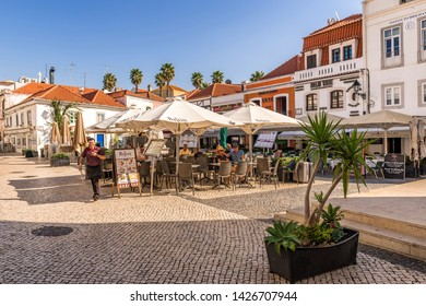 09.11.2018, Lisbon, Portugal. Open air restaurant on a traditional cobbled street Cascais Portugal