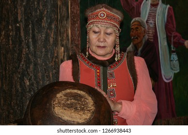 09.12.2008, Yakutsk, Russia. An elderly woman in national costume conducts a tour of the museum and talks about authentic dishes of the Yakut people.