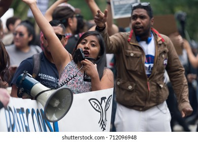 09/17 Central Park, New York City. The leader of the DACA march leads a chant while walking into Central Park.