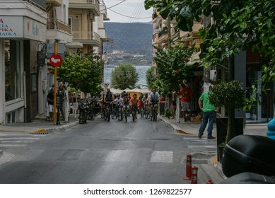 09.20.2008, Hersonissos, Crete, Greece. A group of bicyclers moving by the narrow street.