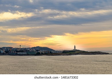09.20.2018. La Coruna, Spain. Sunset behind the tower of Hercules. A roman lighthouse still in use today.