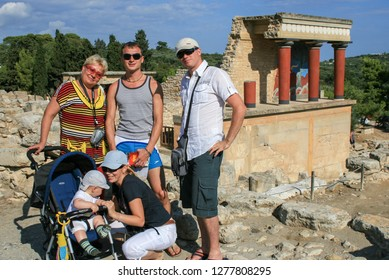 09.23.2008, Hersonissos, Crete, Greece. Travel around Europe by car. Group of tourists on background of Greek ruins.