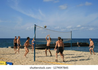 09.27.2008, Hersonissos, Crete, Greece. Travel around Greece. Group of vocational people playing beach volleyball at sunny day.
