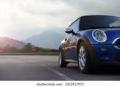 1- 17 May 2017: Mini Cooper in accelerating on highway on background mountains