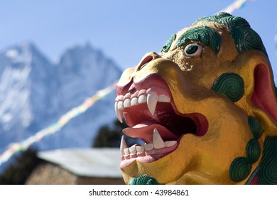 1 of 2 dragon heads guarding the entry gate to the Tengboche Monastery in the Everest region of Nepal