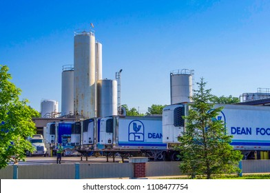 O'fallon, IL—June 1, 2018; refrigerated shipping trailers parked outside milk processing factory and storage silos.  Dean Foods is a regional dairy processor in southern Illinois.