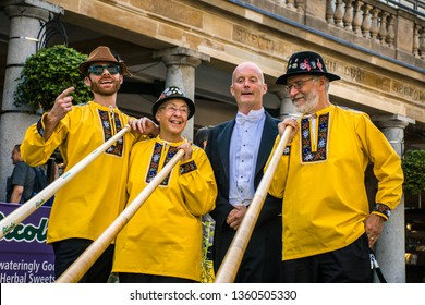 1 August 2018 - England United kingdom : Swiss herbal sweets experts, Ricola, put on a performance to remember in central London (Covent Garden) - 3 mans wearing yellow uniforms and playing Alphorn