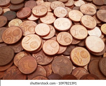 1 cent euro coins, 2 cent euro coins and 5 cent euro coins. Pile of euro cent coins.