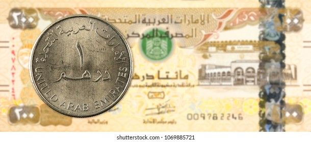 1 dirham coin against 200 united arab emirates dirham bank note obverse