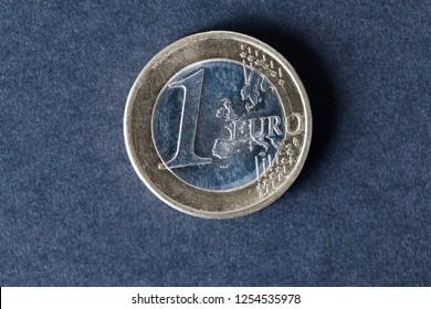1 Euro coin lying on black paper, closeup of obverse coin, European Union