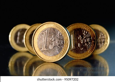 1 Euro coins in front of black background