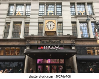 1 February 2017 - New York City: Main entrance of R H Macy and Co (aka Macy's) Department store in Midtown Manhattan on 34th Street.  Famous Macy's clock in front of world's largest store.