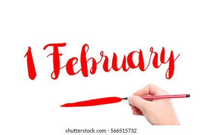 1 February written by hand on a white background