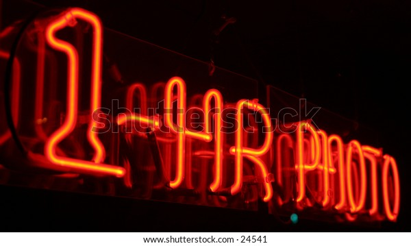 1 hour photo neon sign taken with a short time laps (bulb exposure) for effect