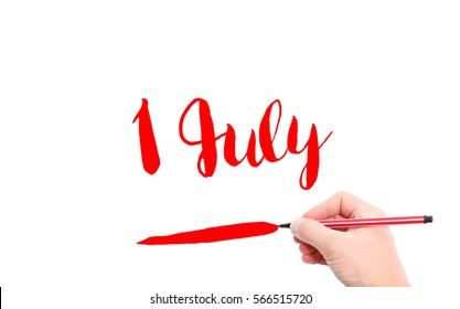 1 July written by hand on a white background