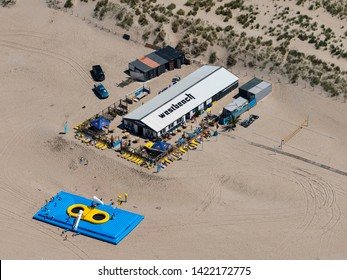 1 June 2019, Monster, Holland. Aerial view of a beach club Strandtent Westbeach at the sandy coastline of Monster in The Netherlands.