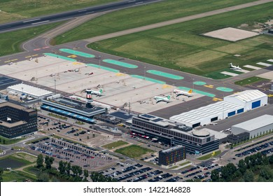 1 June 2019, Rotterdam, Holland. Aerial view of runway, arrival and departure hall at Rotterdam The Hague Airport. A renovation is going on. Planes of Transavia and Pegasus Flypgs.com are on platform.