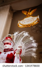 1 March 2019, Venice, Veneto, Italy: woman with mask and costume during carnival celebrations in front of La Fenice Theatre