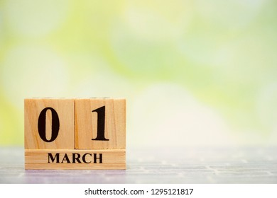 1 March. Wood block calendar on blurred green bokeh background. Free space for any text design. Spring time. Event, Special day.