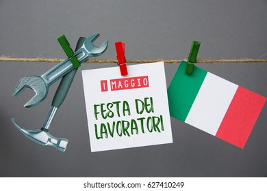 1 May Workers Day (labor day) text in  italian. italy flag, Hammer and wrench - grunge abstract image