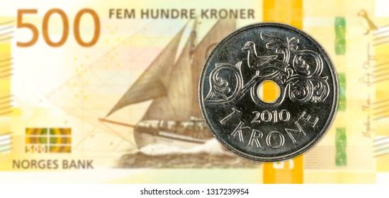 1 norwegian krone coin against 500 new norwegian krone banknote