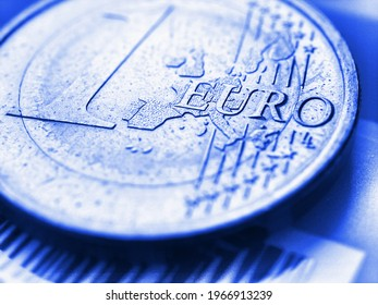 1 one euro coin close-up. The name of the Eurozone currency in focus. Light blue tinted background. Bright backdrop about economy and finance of the European Union. Macro - Shutterstock ID 1966913239