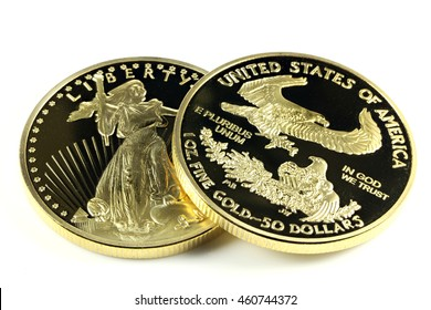 1 ounce American gold eagle bullion coins isolated on white background