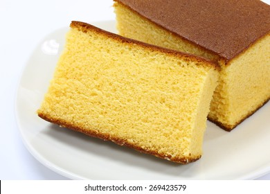 1 Pieces Cutted Homemade Castella Cake on White Ceramic Plate