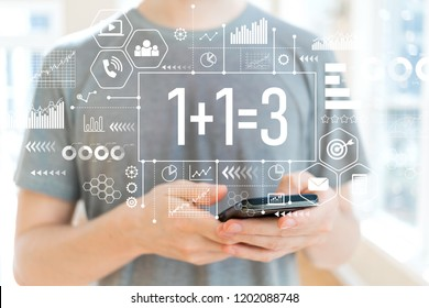 1 plus 1 equal 3 with young man using a smartphone