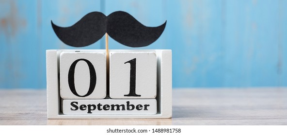 1 September Calendar and mustache on wood table background. Father, International men day, Prostate Cancer Awareness and World cancer day concept