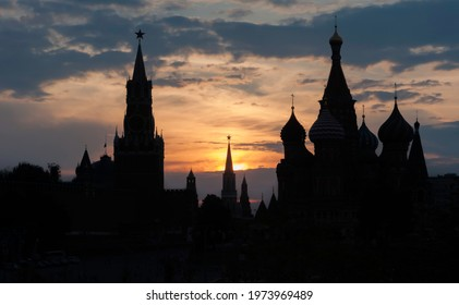 1.Sunset over Moscow. Basil's Sabor in Moscow. The Kremlin and St. Basil's Cathedral on a summer  night. Tour to Russia. Travel to Moscow.