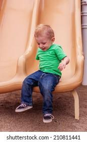 1 year old boy playing at the park -- image taken at San Rafael Park in Reno, Nevada, USA