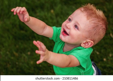 1 year old boy playing at the park -- image taken at San Rafael Park in Reno, Nevada, USA