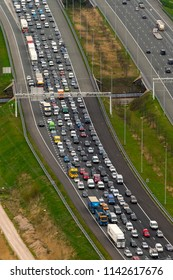 10 April 2018, Breukelen, Holland. Aerial bird view of heavy traffic jam at highway A2. The freeway connects Utrecht with Amsterdam.