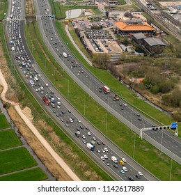 10 April 2018, Breukelen, Holland. Aerial bird view of heavy traffic jam at highway A2. The freeway connects Utrecht with Amsterdam. On the right Hotel van der Valk.
