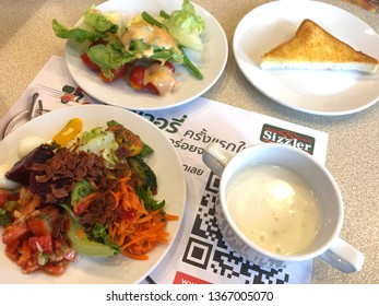 10 April 2019; Nonthaburi Thailand: Dishes of Salad and mushroom soup at Sizzler
