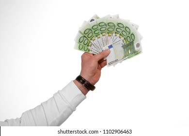 10 banknotes of 100 euros held in hand as a fan in front of white background